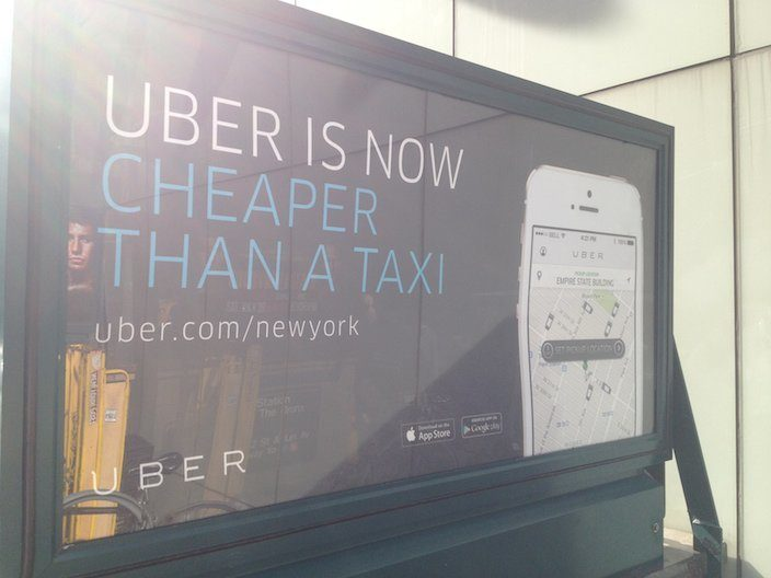 This picture shows how Uber uses a NYC street ad to generate landing page visits and new signups.