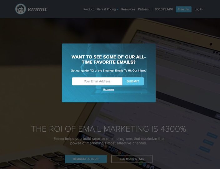 This picture shows how Emma email marketing software uses a delayed popup squeeze page to generate conversions.